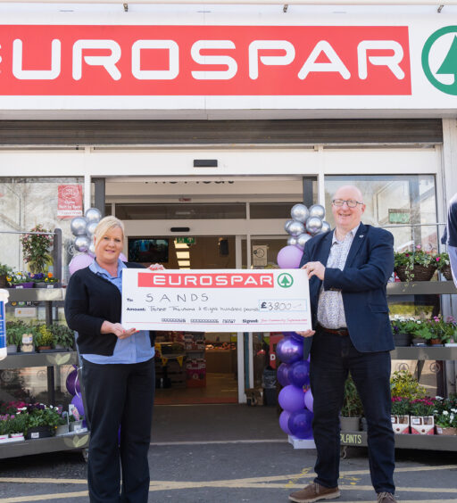 Local supermarket staff make donation to SANDS in support of colleague